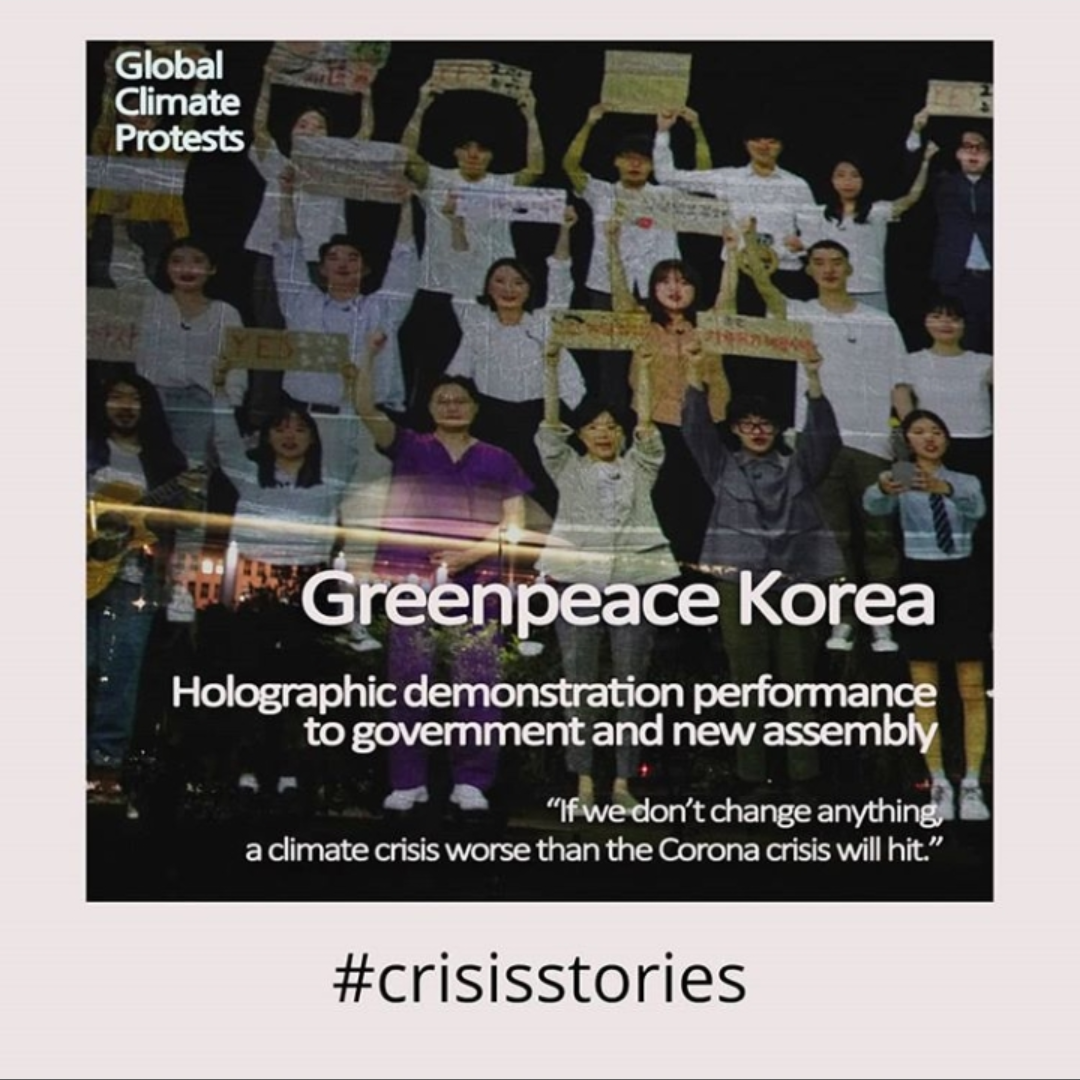 This poster shows a holographic demonstration with Koreans holding up signs with messages.