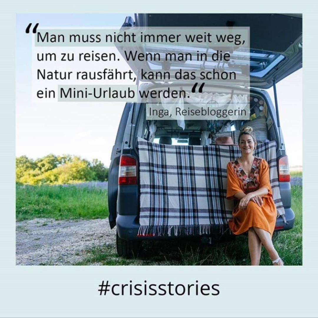 The picture shows travel blogger Inga sitting in her camper.
